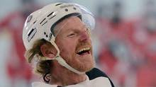 In this file photo, Ottawa Senators Daniel Alfredsson has a laugh during practice at the Bell Sensplex in Ottawa on Monday, January 7, 2013. Alfredsson is joining the Detroit Red Wings to make a one-year run at the Stanley Cup, and Stephen Weiss is in it for the long haul in the Motor City. Detroit got a deal done mere minutes after NHL teams could sign free agents on Friday afternoon, July 5, 2013, with Alfredsson, and agreed to terms with Weiss a couple hours later. (SEAN KILPATRICK/THE CANADIAN PRESS)