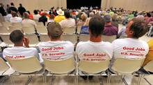 Workers wearing anti-OPEC shirts listen during the U.S. State Department's open hearing for the proposed Keystone XL Pipeline at the Port Arthur Civic Center in Port Arthur, Texas, Monday, Sept. 26, 2011. (Guiseppe Barranco/AP)