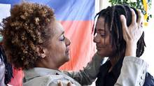 Governor General Michaelle Jean hugs Maile Alphonse during her visit to Jacmel, Haiti last March. Ms. Alphonse lost her mother in the earthquake, who was the godmother of Ms. Jean's daughter Marie-Eden. (Paul Chiasson)