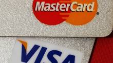 Jim Flaherty is taking an in-depth look at the dismissal of a major case against Visa Canada Corp. and MasterCard International Inc., raising the possibility that the finance minister could attack the issue from the regulatory front. (Bobby Yip/Reuters)