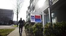 Canada's housing market has been cooling markedly in the wake of new mortgage restrictions last summer, and a report expected Friday from the Canadian Real Estate Association will drive that point home. (Rafal Gerszak for The Globe and Mail)