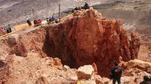 A view of the crater at the top of Cerro Rico mountain which measures 17 meters in diameter and 22 meters in depth in Potosi, Bolivia, on January 25, 2011. (REUTERS/REUTERS)