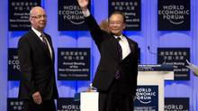 Chinese Premier Wen Jiabao, right, waves as he arrives with Klaus Schwab, the founder and Executive Chairman of World Economic Forum at the opening of the World Economic Forum's Annual Meeting of the New Champions in Tianjin, China Tuesday, Sept. 11, 2012. (Andy Wong/AP)