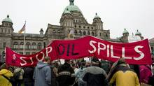 Protesters take part in a mass sit-in in front of the British Columbia legislature in Victoria, B.C. on Oct. 22, 2012, to protest the proposed Northern Gateway pipeline. (JONATHAN HAYWARD/THE CANADIAN PRESS)