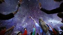 Athletes react as confetti rains down on them during the Closing Ceremony at the 2012 Summer Olympics, Monday, Aug. 13, 2012, in London. (Jae C. Hong/AP)
