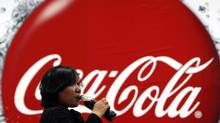 A visitor drinks a bottle of Coca-Cola during a media tour at PT Coca-Cola Amatil Indonesia's factory in Cibitung, Indonesia's West Java province in this February 24, 2011 file photograph. (BEAWIHARTA/REUTERS)
