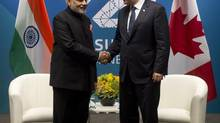 Canadian Prime Minister Stephen Harper shakes hands with Indian Prime Minister Narendra Modi before a bi-lateral meeting at the G20 Summit in Brisbane, Australia Saturday November 15, 2014. Anticipation of an Indian prime minister's first visit to Canada in 42 years is building as fans and foes of Narendra Modi see him as either a rock star of economic development that could benefit both countries or a suppressor of minority rights. (Adrian Wyld/The Canadian Press)
