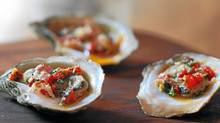 Char-grilled Louisiana oysters. (Tim Fraser for The Globe and Mail)