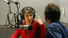 Republican candidate for U.S. Senate Carly Fiorina (L) adjusts her headphones prior to a radio debate with incumbent U.S. Sen. Barbara Boxer (D-CA) who is in Washington D.C. as co-moderator Gabriel Lerner, metro editor of La Opinion, looks on at local public-radio affiliate KPCC studios September 29, 2010 in Pasadena, California. (Anne Cusack-Pool/Getty Images/Anne Cusack-Pool/Getty Images)