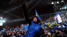 Supporters greet Ukraine's Regions Party and the Presidential candidate Viktor Yanukovich during a rally in Kiev. Ukrainians go to the polls on February 7, 2010 to vote on the second round of the presidential elections. (SERGEI SUPINSKY/AFP/Getty Images)