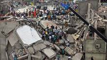 Bangladeshi rescuers work at the site of a building that collapsed Wednesday in Savar, near Dhaka, Bangladesh, Thursday, April 25, 2013. (A.M. Ahad/AP)