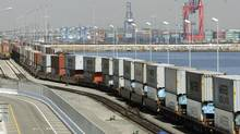 Hundreds of shipping containers move in a train at the Port of Los Angeles in this file photo. (REED SAXON/AP)