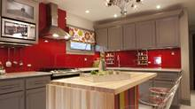 Meg Caswell, host of HGTV's Great Rooms, loves adding colours to kitchens. Here she painted the walls red and added a clear glass cover to create a chic, vibrant backsplash. (Jean-Marc Giboux/AP)