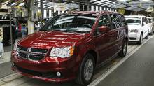 Fiat Chrysler's Dodge minivans move down the final production line at the Windsor Assembly Plant in Windsor, Ontario, February 9, 2015. (Rebecca Cook/REUTERS)