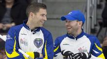 British Columbia skip John Morris, left, and vice skip Jim Cotter share a laugh in draw 12 action against Newfoundland and Labrador at the Tim Hortons Brier curling championship at Mile One Centre in St. John's on Wednesday, March 8, 2017. (Andrew Vaughan/THE CANADIAN PRESS)