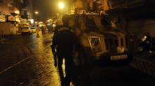 Police patrol the site near a bomb blast at Zaveri Bazaar in Mumbai on Wednesday. (Prakash Singh/AFP/Getty Images)