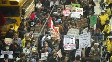 Occupy Toronto supporters demonstrate on Churst Street in Toronto on Oct. 17, 2011. (Kevin Van Paassen/Kevin Van Paassen/The Globe and Mail)