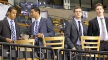 NHL entry draft prospects (left) Darnell Nurse and Seth Jones watch a Boston Bruins practice in Boston, Mass., Tuesday, June 18, 2013. The 2013 NHL Draft is set for June 30 at Prudential Center in Newark, N.J. (Neil Davidson/THE CANADIAN PRESS)