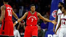 Toronto Raptors point guard Kyle Lowry celebrates a second-half basket with DeMar DeRozan while playing the Detroit Pistons at the Palace of Auburn Hills on April 5, 2017 in Auburn Hills, Michigan. (Gregory Shamus/Getty Images)