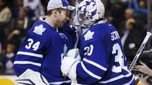 Toronto Maple Leafs goalies James Reimer and Ben Scrivens (R) celebrate after their team defeated the Florida Panthers during the third period of their NHL game in Toronto March 26, 2013. (MARK BLINCH/REUTERS)