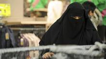 A woman wearing a niqab shops in a supermarket during the first day of winter sales in Leers, northern France, January 6, 2010. (STRINGER/FRANCE/REUTERS)