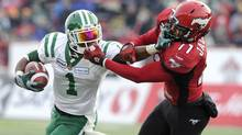 The Saskatchewan Roughriders' Kory Sheets, left, kicked off the 2013 season with six consecutive 100-yard rushing games. (LARRY MACDOUGAL/THE CANADIAN PRESS)