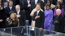 President Barack Obama, the first family, and other government officials listen as Beyoncé sings the national anthem for the presidential public swearing-in during the 57th inauguration at the Capitol Building in Washington. From left: House Speak John Boehner (R-Ohio), Beyoncé, Sen. Charles Schumer (D-N.Y.), Obama, Sasha and Malia Obama and Vice-President Joe Biden. (DOUG MILLS/NYT)