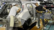 Employees assemble the Nissan Leaf electric vehicle at the Oppama plant in Yokosuka city, near Tokyo, on July 2, 2011. Nissan started factory operation on Saturday and Sunday this month as Japan Automobile manufacturers Association agreed to close their factories on Thursday and Friday for power saving due to the expected power shortage in the wake of the March 11 earthquake and nuclear disaster. (YOSHIKAZU TSUNO/YOSHIKAZU TSUNO/AFP/Getty Images)