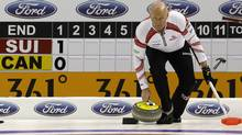 Canada skip Glenn Howard delivers his stone during play against Switzerland at the World Men's Curling Championship 2012 in Basel April 3, 2012. (ARND WIEGMANN/Reuters)