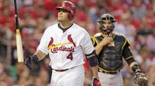 St. Louis Cardinals' Yadier Molina (4) tosses his bat in frustration after being called out on strikes as Pittsburgh Pirates catcher Russell Martin looks on in the fourth inning of a baseball game, Tuesday, July 8, 2014 in St. Louis. (Tom Gannam/AP)