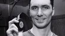 Andy Bathgate, veteran New York Rangers wing, is shown in the dressing room at New York's Madison Square Garden on Jan. 2, 1963. Bathgate, who played for Toronto, Detroit, New York and Pittsburgh over 17 NHL seasons, has died. (THE ASSOCIATED PRESS)