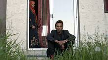 Somalian refugees Khadro Mohamed and her son Saeed Jama 23, pictured at their home in Edmonton on June 21, 2012. Saeed Jama is facing deportation because of his criminal record though he has never actually been to Somalia. (Jason Franson for The Globe and Mail)