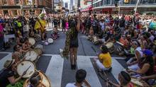 People from the Black Lives Matter stage a sit-in during the annual Pride Parade in Toronto on Sunday, July 3, 2016. (Mark Blinch/THE CANADIAN PRESS)