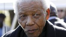 The South African presidency says former South African President Nelson Mandela has been discharged from a hospital after an improvement in his condition. Officials say he was treated for pneumonia. He is pictured here in a June 17, 2010 file photo. (Siphiwe Sibeko/AP)