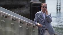 Liberal Leader Justin Trudeau's chief advisor Gerald Butts speaks on his phone as Trudeau holds a news conference in North Vancouver, B.C., on Friday May 29, 2015. (DARRYL DYCK/THE CANADIAN PRESS)