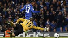Manchester United's goalkeeper Anders Lindegaard dives for the ball as Chelsea's Daniel Sturridge scores during extra time in their English League Cup match at Stamford Bridge in London October 31, 2012. (SUZANNE PLUNKETT/REUTERS)