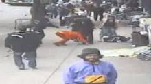 In an image captured by CCTV, the person in red is a disabled woman being pushed to the ground by Vancouver Police Constable Taylor Robinson in June 2010.