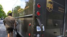 UPS is holding onto its earnings expectations for the full year after reporting a 5 per cent increase in third-quarter earnings on Oct. 25, 2011. (Paul Sakuma/AP/Paul Sakuma/AP)