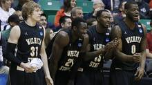 Wichita State players from left, Ron Baker, Ehimen Orukpe, Nick Wiggins and Chadrack Lufile, celebrate on the sideline during the second half of a second-round game in the NCAA college basketball tournament against Pittsburgh Thursday, March 21, 2013, in Salt Lake City Wichita State won 73-55. (Associated Press)