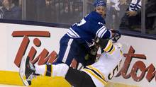 Leafs Leo Komarov hits Bruins Adam McQuaid during the first period of game six of the first round NHL Stanley Cup Playoff game between the Toronto Maple Leafs and the Boston Bruins at the Air Canada Centre in Toronto on May 12, 2013. (Peter Power/The Globe and Mail)
