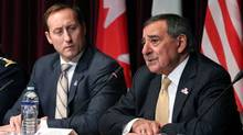 Canadian Defence Minister Peter MacKay, left, listens beside U.S. Secretary of Defence Leon Panetta at a trilateral meeting in Ottawa on Tuesday. (Patrick Doyle/Reuters)