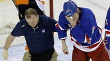 New York Rangers' Marc Staal is helped by a trainer after being injured during the third period of an NHL hockey game against the Philadelphia Flyers on Tuesday, March 5, 2013, in New York (Associated Press)