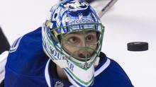 Vancouver Canucks goaltender Roberto Luongo watches a shot from the L.A Kings during NHL playoff action in Vancouver April 13, 2012. (John Lehmann/The Globe and Mail) (John Lehmann/The Globe and Mail)