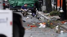 "Evidence teams investigate at the scene of Saturday's explosion in Manhattan, Sept. 19, 2016. Ottawa has no roll-out date for the kind of ""public warning system"" used in the U.S. over the weekend after bombings in New York and New Jersey. (Jason DeCrow/AP)"