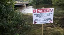 A warning sign is posted on the banks of the Kalamazoo River in Augusta, Mich., Aug. 1, 2010, after an Enbridge oil pipeline ruptured, spewing more than 3 million litres of crude into the waterway. The bosses of Canada's largest pipeline companies acknowledged Wednesday more has to be done to win public confidence when it comes to pipeline safety. (Kevin Van Paassen/The Globe and Mail)