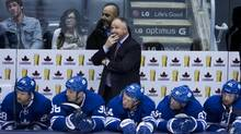Leafs Head Coach Randy Carlyle looks up at the clock (Peter Power/The Globe and Mail)