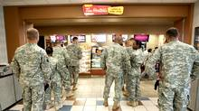 Soldiers at Fort Knox line up for coffee at Tim Hortons.
