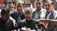 India's Finance Minister Pranab Mukherjee speaks with the media after presenting the 2011-2012 economic survey report, outside the parliament in New Delhi March 15, 2012. (B MATHUR/REUTERS)