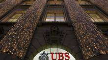 Christmas lights are illuminated at an office building of Swiss bank UBS in Zurich Dec. 4, 2012. U.S. group General Electric wants to sell its Swiss consumer lending business and UBS is a possible bidder, sources said Tuesday. (Arnd Wiegmann/Reuters)