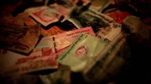 Asian currency is seen in this photo illustration in Singapore January 17, 2013. (Thomas White/Reuters)